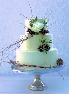 Buttercream with Flowers and Twigs Wedding Cake