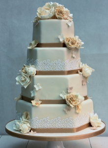 Hexagonal Cake with Lace and Flower Clusters Wedding Cake